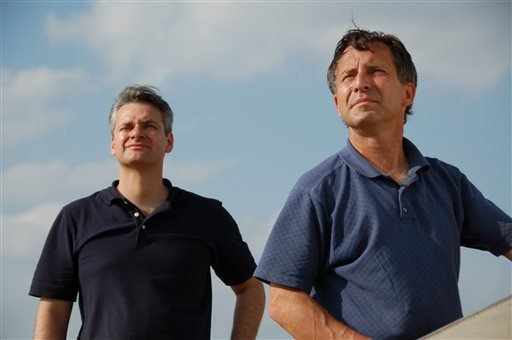This undated photo provided by The Discovery Channel shows Carl Young, left, and Tim Samaras watching the sky.