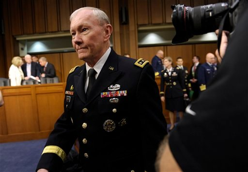Joint Chiefs Chairman Gen. Martin Dempsey arrives on Capitol Hill June 4, 2013, to testify before the Senate Armed Services Committee on pending legislation regarding sexual assaults in the military. (AP Photo/Susan Walsh)