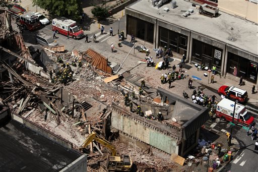 Rescue personnel work the scene of a building collapse in downtown Philadelphia, Wednesday, June 5, 2013.