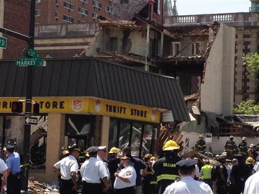Emergency personnel respond to a building collapse in downtown Philadelphia, where the city fire commissioner says as many as eight to 10 people are believed trapped in the rubble, Wednesday, June 5, 2013.