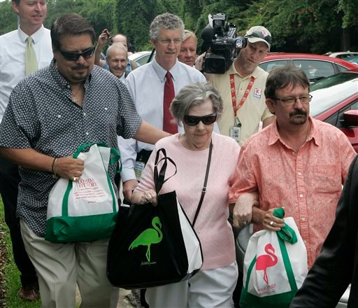 Powerball winner Gloria C. Mackenzie, 84, leaves the lottery office escorted by her son Scott Mackenzie, right, after claiming a single lump-sum payment of about $370.9 million before taxes on Wednesday, June 5, 2013, in Tallahassee, Fla. (AP)