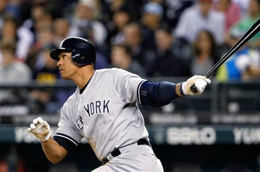 In this July 23, 2012, file photo, New York Yankees' Alex Rodriguez watches a home run against the Seattle Mariners in a baseball game in Seattle.
