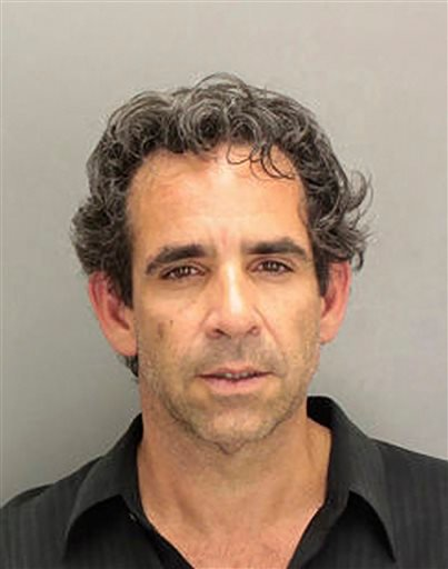 This undated booking photo provided by the Miami-Dade Police Department, on Tuesday, Jan 29, 2013, shows Anthony Bosch.