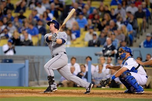 San Diego Padres' Jedd Gyorko, left, hits a solo home run as Los Angeles Dodgers catcher Tim Federowicz looks on during the fourth inning of their baseball game, Wednesday, June 5, 2013, in Los Angeles. (AP Photo/Mark J. Terrill)