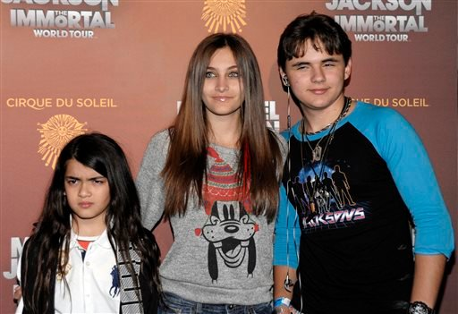 This Jan. 27, 2012 file photo shows, from left, Blanket Jackson, Paris Jackson, and Prince Michael Jackson at the opening night of the Michael Jackson The Immortal World Tour in Los Angeles.