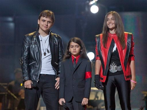 """In this Oct. 8, 2011 file photo, from left, Prince Jackson, Prince Michael II """"Blanket"""" Jackson and Paris Jackson arrive on stage at the Michael Forever the Tribute Concert, at the Millennium Stadium in Cardiff, Wales."""