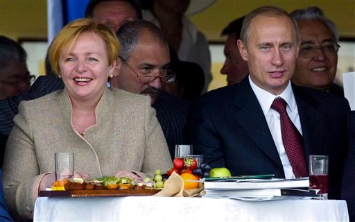 In this file photo taken on July 3, 2004, President Vladimir Putin and then his wife Lyudmila watch during horse races at the Moscow Central Hippodrome, Russia. (AP Photo/Alexander Zemlianichenko, File)