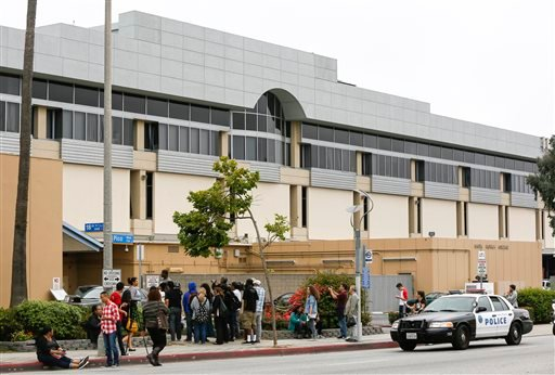 Students stand outside the north side of Santa Monica College campus in Santa Monica, Calif. Friday, June 7, 2013. (AP)