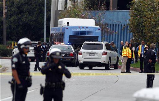 Investigators look at a Santa Monica City Bus that was shot at in Santa Monica, Calif. Friday, June 7, 2013. (AP)