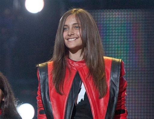 FILE - In this Oct. 8, 2011 file photo Paris Jackson smiles on stage at the Michael Forever the Tribute Concert, at the Millennium Stadium in Cardiff, Wales. (AP)