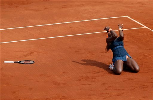 Serena Williams, of the U.S, reacts as she defeats Russia's Maria Sharapova during the Women's final match of the French Open tennis tournament at the Roland Garros stadium Saturday, June 8, 2013 in Paris. (AP Photo/Christophe Ena)