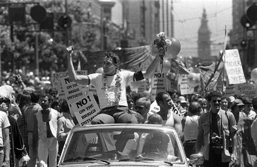 FILE - In this June 26, 1978 file photo, San Francisco Supervisor Harvey Milk greets the crowd as he rides in a convertible in San Francisco's seventh annual gay freedom parade. (AP Photo/File)