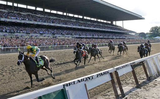 Palace Malice, left, ridden by jockey Mike Smith, wins the 145th Belmont Stakes horse race at Belmont Park Saturday, June 8, 2013, in Elmont, N.Y. (AP Photo/Frank Franklin II)