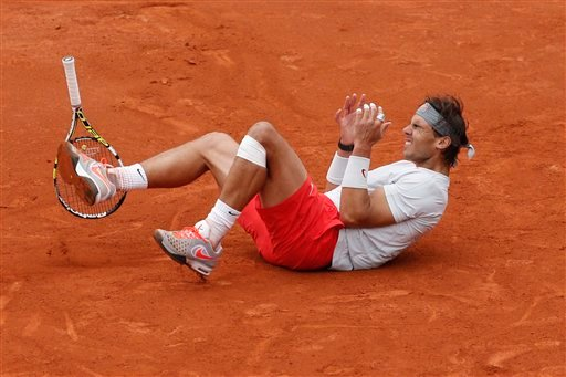 Spain's Rafael Nadal celebrates winning against compatriot David Ferrer in three sets 6-3, 6-2, 6-3, in the final of the French Open tennis tournament, at Roland Garros stadium in Paris, Sunday June 9, 2013. (AP Photo/Christophe Ena)