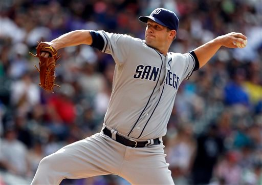 San Diego Padres starting pitcher Eric Stults works against the Colorado Rockies in the first inning of a baseball game in Denver, Saturday, June 8, 2013. (AP Photo/David Zalubowski)