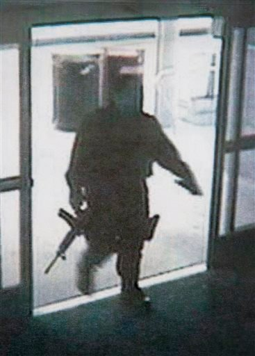 Photo: Santa Monica PD during a news conference June 8, 2013, shows a frame grab from a surveillance camera revealing the suspect entering Santa Monica College Friday, in Santa Monica.(AP Photo/Santa Monica Police Department)