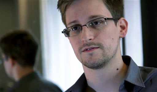 This photo provided by The Guardian Newspaper in London shows Edward Snowden, who worked as a contract employee at the National Security Agency, on Sunday, June 9, 2013, in Hong Kong.