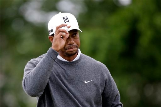 Tiger Woods reacts after putting on the 14th hole during the first round of the U.S. Open golf tournament at Merion Golf Club, Friday, June 14, 2013, in Ardmore, Pa. (AP Photo/Morry Gash)