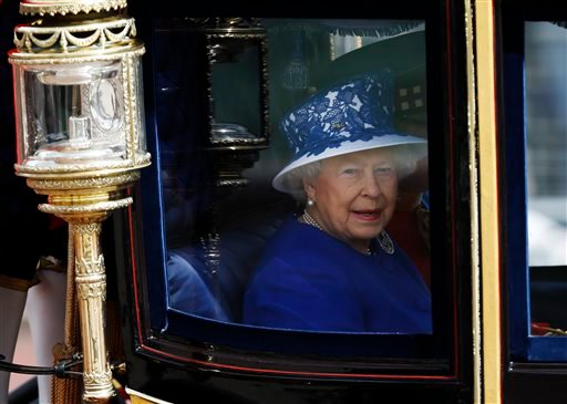 Britain's Queen Elizabeth II leaves Buckingham Palace in a horse drawn carriage for the Trooping The Colour parade, at the Horse Guards Parade in London, Saturday, June 15, 2013.