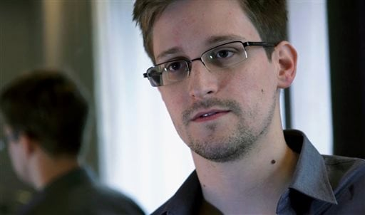 FILE - This June 9, 2013 photo provided by The Guardian newspaper in London shows Edward Snowden, who worked as a contract employee at the U.S. National Security Agency, in Hong Kong. (AP)