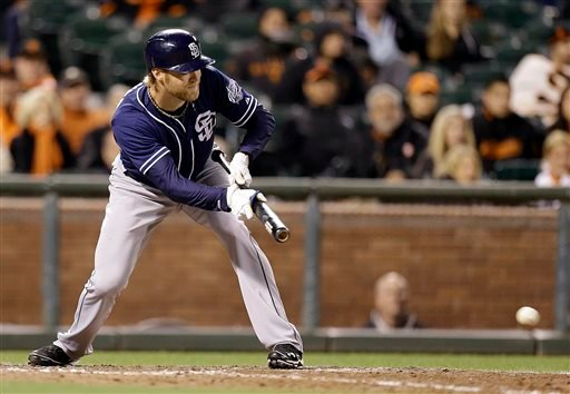 San Diego Padres' Andrew Cashner hits an RBI bunt against the San Francisco Giants' in the 13th inning of a baseball game Monday, June 17, 2013, in San Francisco. (AP Photo/Ben Margot)