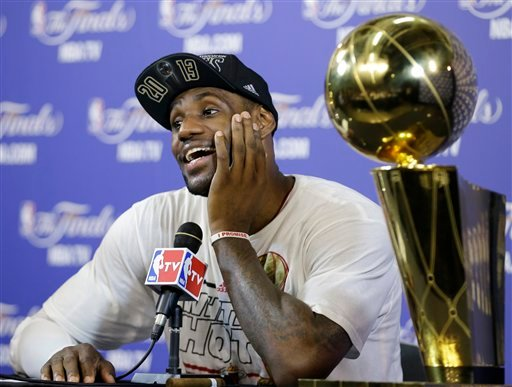 The Miami Heat's LeBron James smiles during a post game news conference following Game 7 of the NBA basketball championship game against the San Antonio Spurs, Friday, June 21, 2013, in Miami.