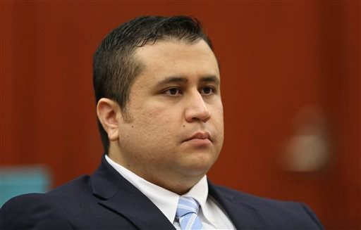 This June 20, 2013 file photo, George Zimmerman listens as his defense counsel Mark O'Mara questions potential jurors during Zimmerman's trial in Seminole circuit court in Sanford, Fla.