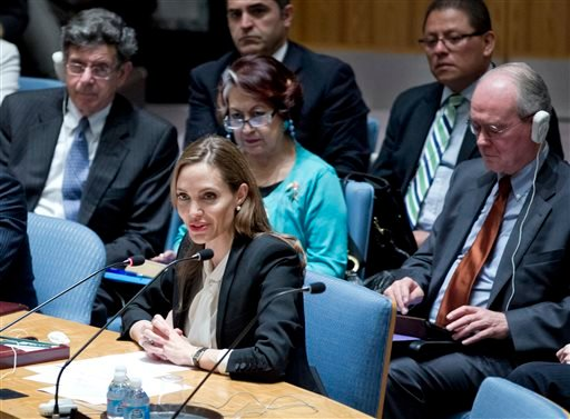 In this photo provided by the United Nations, actress Angelina Jolie makes her debut before the Security Council at the U.N. headquarters as a special envoy for refugees to urge the world's nations to make the fight against rape in war a top priority.
