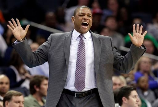 FILE - In this Feb. 11, 2013 file photo, Boston Celtics head coach Doc Rivers reacts to a call during the first half of an NBA basketball game against the Charlotte Bobcats in Charlotte, N.C. (AP)