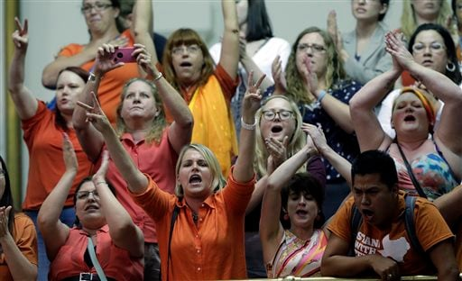 Members of the gallery cheer and chant as the Texas Senate tries to bring an abortion bill to a vote as time expires, Wednesday, June 26, 2013, in Austin, Texas. (AP Photo/Eric Gay)
