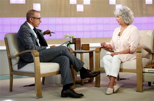 "In this publicity image released by NBC, celebrity chef Paula Deen appears on NBC News' ""Today"" show, with host Matt Lauer, Wednesday, June 26, 2013 in New York. (AP)"
