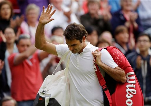 Roger Federer of Switzerland waves to the crowd as he walks off the court after his defeat to Sergiy Stakhovsky of Ukraine in their Men's second round singles match at the All England Lawn Tennis Championships in Wimbledon, London. (AP)