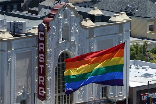 A rainbow flag flies in front of the Castro Theater in San Francisco, Wednesday, June 26, 2013. (AP Photo/Jeff Chiu)