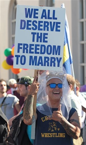 Hank Cancel celebrates the U. S. Supreme Court's rulings on Prop. 8 and DOMA in the Castro District in San Francisco on Wednesday, June 26, 2013. (AP Photo/Mathew Sumner)