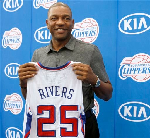Former Boston Celtics head coach Doc Rivers holds his new Los Angeles Clippers jersey during a press conference in Los Angeles on Wednesday, June 26, 2013.