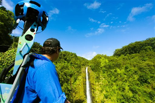 In this undated photo provided by Google, Rob Pacheco, president of Hawaii Forest & Trail, takes in the view at Akaka Falls near Honomu, Hawaii, while wearing the Street View Trekker.