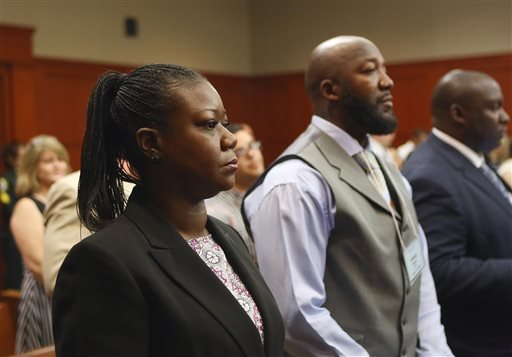 Trayvon Martin's parents, Sybrina Fulton, left, and Tracy Martin, center, attend George Zimmerman's trial in Seminole circuit court in Sanford, Fla. on Thursday, June 27, 2013. (AP)