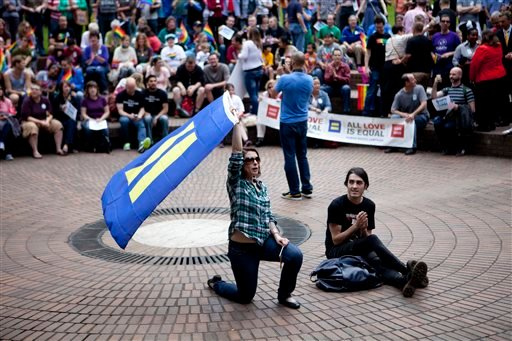 FILE - Community members and local leaders hold a rally in Terry Schrunk Plaza in Portland, Ore. on June 26, 2013 to celebrate the Supreme Court's rulings on the same-sex marriage. (AP)
