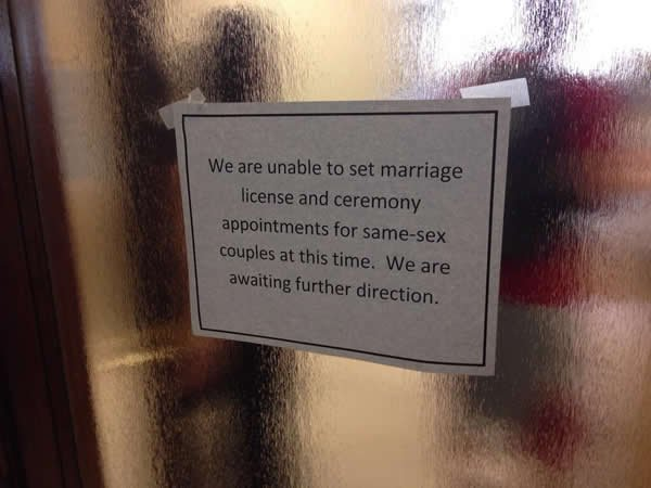This image shows a sign posted at the San Diego County Clerk's Office Friday afternoon. County officials are awaiting word from the Calif. Department of Health to resume same-sex marriages.