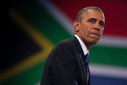 U.S. President Barack Obama pauses during a town hall meeting with young African leaders at the University of Johannesburg Soweto on Saturday, June 29, 2013, in Johannesburg, South Africa.
