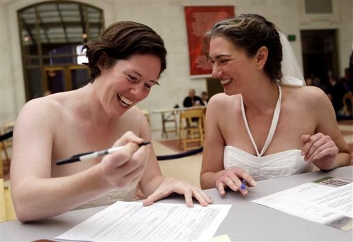 Cynthia Wides, right, and Elizabeth Carey file for a marriage certificate at City Hall in San Francisco, Saturday, June 29, 2013.