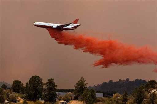 Tanker 910 makes a retardant drop Yarnell Hill Fire to help protect the Double Bar A Ranch near Peeples Valley, Arizona, Sunday, June 30, 2013. The lightning caused blaze began on Yarnell Hill on Sunday. (AP Photo/The Arizona Republic, Tom Story)