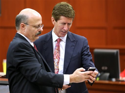 Prosecutor Bernie de la Rionda, left, and defense attorney Mark O'Mara confer during the 15th day of the George Zimmerman trial in Seminole circuit court, in Sanford, Fla., Friday, June 28, 2013.