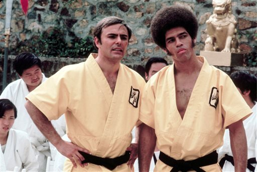 "This 1973 photo released by Warner Bros. Entertainment shows John Saxon as Roper, left, and Jim Kelly as Williams in a scene from ""Enter the Dragon."""