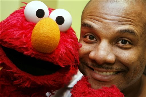 FILE - This Aug 16, 2006 file photo shows Kevin Clash, who was the voice and movements behind Sesame Street's Elmo, posing for a picture with Elmo in New York. (AP)