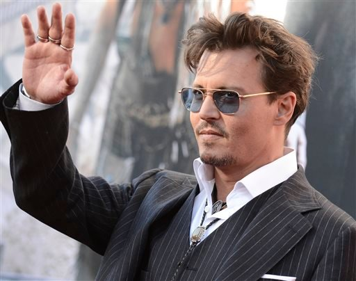 """In this Saturday, June 22, 2013 photo, actor Johnny Depp arrives at the world premiere of """"The Lone Ranger"""" at Disney California Adventure, in Anaheim, Calif."""