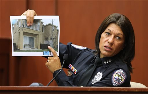 Sanford police officer Doris Singleton holds up a copy of a photo of the complex where the Trayvon Martin shooting took place, while testifying in Seminole circuit court, in Sanford, Fla., Monday, July 1, 2013.