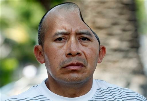 Antonio Lopez Chaj, a 43-year-old house painter, appears with his attorneys at a news conference in Los Angeles Monday, July 1, 2013.