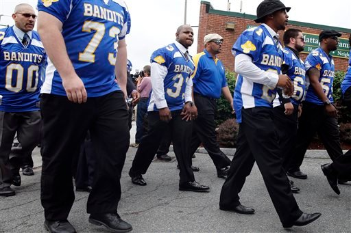 Odin Lloyd's teammates arrive for Lloyd's funeral service at Church of the Holy Spirit in Boston, Saturday, June 29, 2013. (AP)