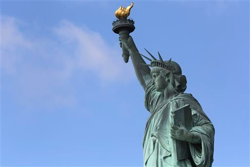 The Statue of Liberty stands against a clear sky Thursday, July 4, 2013, on the first day it opened to tourists since Superstorm Sandy swamped its little island in New York Harbor.